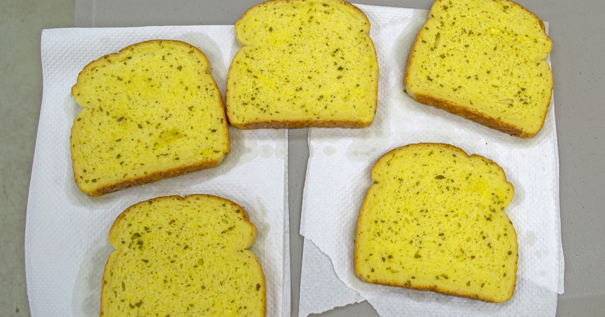 Herb Butter Sprayed On Bread with Wilevco